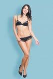 Mooie vrouw in sexy zwarte lingerie Stock Afbeeldingen
