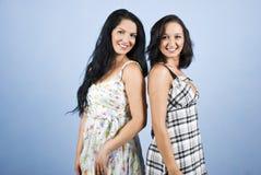 Mooie vrouw twee die met tanden glimlacht Royalty-vrije Stock Foto's