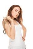 Mooie vrouw in wit vest met handcuffs stock afbeeldingen