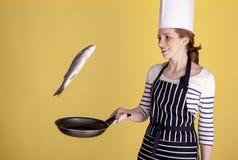 Mooie vrouwelijke chef-kok Stock Afbeeldingen