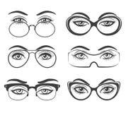 Mooie vrouwelijke ogen in glazen royalty-vrije illustratie