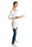 Mooie vrouwelijke tiener met een boek. Royalty-vrije Stock Afbeelding