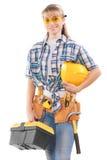Mooie vrouwelijke werknemer met hulpmiddelen royalty-vrije stock afbeelding