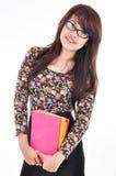 Mooie vrouwen glimlachende en dragende boeken Stock Foto's