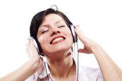 Mooie vrouwen het luisteren muziek Royalty-vrije Stock Foto