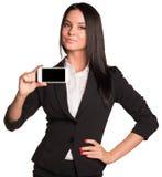 Mooie vrouwen in kostuum die slimme telefoon tonen Stock Foto