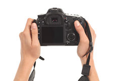 Mooie vrouwenhanden die een dslrcamera houden Royalty-vrije Stock Foto's