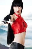 Mooie vrouwenvechter met zwaard in een hand Stock Fotografie