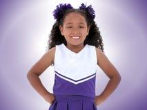 Mooie Zes Éénjarigen Cheerleader over Purple royalty-vrije stock foto's