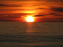 Zonsondergang in Overzees Royalty-vrije Stock Afbeeldingen
