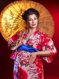 Mooie zwangere geisha Stock Afbeeldingen