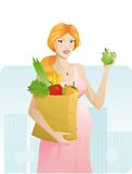 Mooie zwangere vrouw met appel Stock Afbeelding