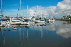 Mooloolaba, Qld, Australia - May 3, 2019: Luxury sailboats reflecting in water. Sailboats reflecting in water on a beautiful sunny day stock photography