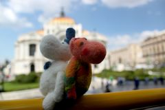 Moomin troll couple travelling around the globe, felted wooden toy stock image