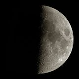 Moon. Astronomy space photo: isolated half Moon on black background with lunar surface details (craters) visible. The high resolution picture was taken on May Royalty Free Stock Photo