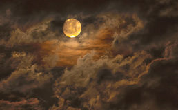 Moon. Fiery and cloudy moon filled sky