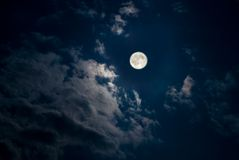 Moon. Beautiful full moon, a shining moon lights up clouds Royalty Free Stock Photo