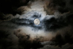 Moon. The moon covered with clouds royalty free stock photo