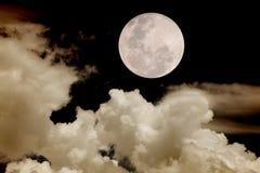 Moon. Big moon passing behind clouds royalty free stock photos
