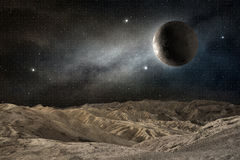Moon above a desert landscape Stock Image