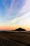 Moon above the Mount. Sunset in mounts bay Cornwall near St. Michele's Mount Royalty Free Stock Image