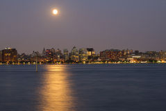 Moon above New York skyline Stock Photos
