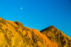 Moon above rocks at Pfeiffer State Park, Big Sur, California Royalty Free Stock Image