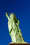 Moon above Statue of Liberty - replica Royalty Free Stock Photo
