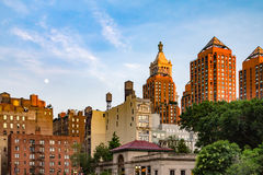 Moon Above Union Square Park in New York City. Moon rising in the sky above Union Square Park at sunset in Manhattan, New York City Royalty Free Stock Images