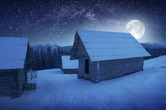 Moon above the village Royalty Free Stock Images