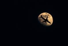 Moon with aeroplane. Aeroplane is flying to the moon stock image