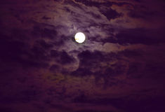 Moon. Against the background of the night sky and clouds Stock Images