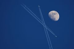 Moon with aircraft Royalty Free Stock Image