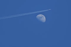 Moon and airliner Royalty Free Stock Photo
