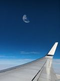 Moon in airplane window Royalty Free Stock Photography