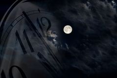 Moon And Clock Royalty Free Stock Photos