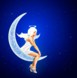 Moon Angel. Beautiful Young Woman in Angel Costume Sitting on the Moon Royalty Free Stock Image