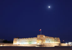 The moon and the arad fort from south west in blue hours Stock Photography