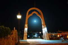 Moon in the arch Stock Photography
