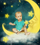 Moon and baby boy Royalty Free Stock Image