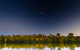 Moon on the background of autumn mirror. Autumn mirror on the river, on a background of the evening moon Stock Photography