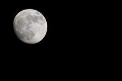Moon beginning lunar eclipse Stock Photos