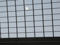 Moon behind the bars, Teheran Royalty Free Stock Photography
