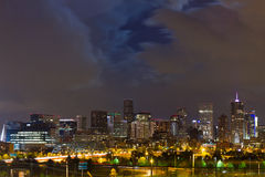 Moon Behind Clouds Above The Denver Skyline Royalty Free Stock Images