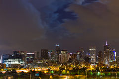 Moon Behind Clouds Above The Denver Skyline Stock Photo