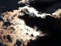 Moon behind the clouds Royalty Free Stock Photos