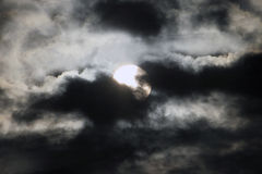 Moon Behind the clouds Royalty Free Stock Photo