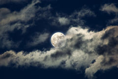 Moon behind the clouds Stock Photography