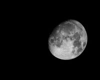 The Moon. Black and white Moon separated from black background royalty free stock photography