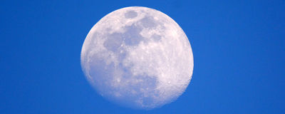 Moon in blue sky Royalty Free Stock Image